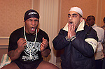 Mike Tyson prays with a fan during a break in training in a Park Lane hotel