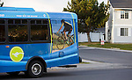 Mountain Line bus in Missoula Montana. Bolt bus with Nelson Kenter photography on side