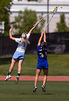 Laura Zimmerman (1) of North Carolina goes up for a free ball against Jillian Heinz (30) of Duke during the ACC women's lacrosse tournament semifinals in College Park, MD.  North Carolina defeated Duke, 14-4.