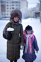 A portrait of a woman and her child on a street in Yakutsk. Yakutsk is one of the coldest cities on earth, with winter temperatures averaging -40.9 degrees Celsius.