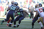 Seattle Seahawks running back Thomas Rawls (34) cuts the corner while tight end Jimmy Graham (88) blocks San Francisco 49ers linebacker Michael Wilhoite (57) at CenturyLink Field in Seattle, Washington on November 22, 2015.  The Seahawks beat the 49ers 29-13.   ©2015. Jim Bryant Photo. All RIghts Reserved.