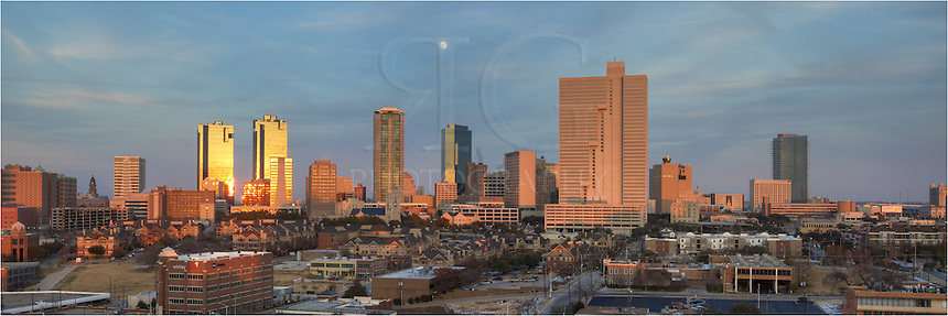 Early evening over Fort Worth Texas. This Ft Worth Panorama includes architectural buildings such as the Wells Fargo Tower, the Forth Worth Tower, the Burnett Plaza and the Omni Hotel.