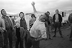 Appleby Gypsy Fair 1981. Gypsy throws two pennies up - its a game of chance. If both coins land heads up or tails up you win depending on your call. Heads and Tails everyone looses apart from the thrower upper of the coins.