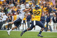 Landover, MD - September 23, 2016: BYU Cougars defensive back Tanner Jacobson (25) breaks up a pass intended for West Virginia Mountaineers wide receiver Devonte Mathis (82) during game between BYU and WVA at  FedEx Field in Landover, MD.  (Photo by Elliott Brown/Media Images International)