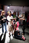 CAPE TOWN, SOUTH AFRICA - AUGUST 13: Nkhensani Nkosi (C) checks a model's hair and makeup before a show with Stoned Cherrie, her fashion label, at the African Fashion International Cape Town fashion week on August 13, 2010, at the Cape Town International Convention Center, in Cape Town, South Africa. Stoned Cherrie is founded by Nkhensani Nkosi, age 37, a mother of four and a celebrated fashion designer, entrepreneur, television personality and an actress in South Africa. She launched her new collection Love Movement at this event. (Photo by Per-Anders Pettersson)
