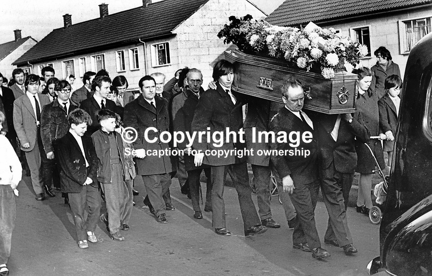 Funeral of Sean Russell, a 30 year old Roman Catholic member of the UDR moves off from his home in the New Barnsley estate in West Belfast, N Ireland. Mr Russell was one of a small number of Roman Catholics to join the UDR in the early days of the Troubles and the first of his co-religionists in the regiment to die. Mr Russell was shot dead by a masked gunman, almost certainly a member of the Provisional IRA, as he sat watching television. 197112100500SR2<br /> <br /> Copyright Image from Victor Patterson, 54 Dorchester Park, Belfast, UK, BT9 6RJ<br /> <br /> t: +44 28 90661296<br /> m: +44 7802 353836<br /> vm: +44 20 88167153<br /> e1: victorpatterson@me.com<br /> e2: victorpatterson@gmail.com<br /> <br /> For my Terms and Conditions of Use go to www.victorpatterson.com
