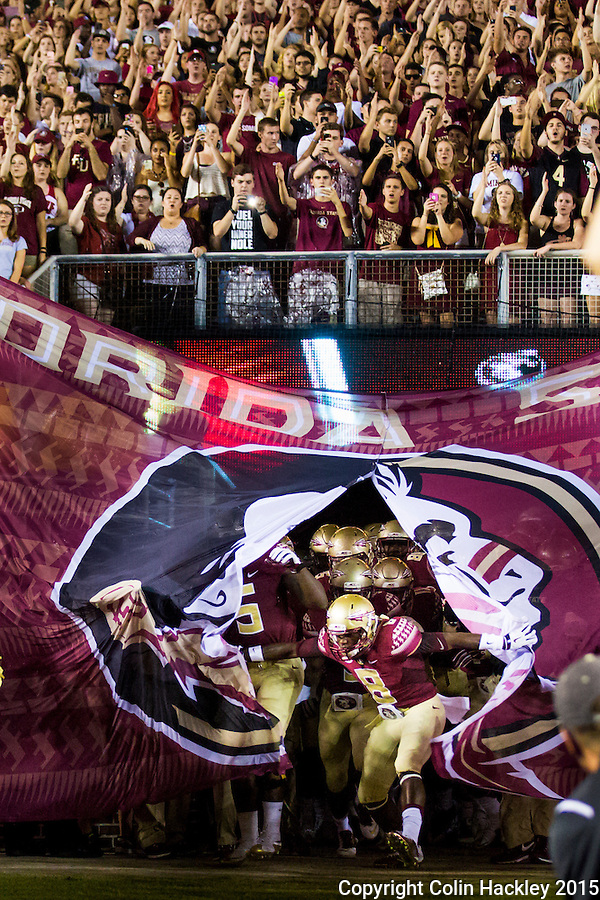 TALLAHASSEE, FLA. 9/5/15-Kermit Whitfield opens the curtain on the 2015 football season as he busts through the banner just before the Florida State University vs. Texas State University football game at Doak Campbell Stadium in Tallahassee.<br /> <br /> COLIN HACKLEY PHOTO