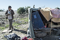 Samuel is from Guerrero south of Mexico. He was deported 5 years ago while was working as a  peaches farmer in California. He is recycling now anything he can to collect some money in a camp at the canal. Tijuana, Mexico. Jan 05, 2015