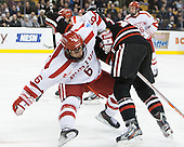 Alexx Privitera (BU - 6), Kevin Roy (NU - 15) - The Northeastern University Huskies defeated the Boston University Terriers 3-2 in the opening round of the 2013 Beanpot tournament on Monday, February 4, 2013, at TD Garden in Boston, Massachusetts.