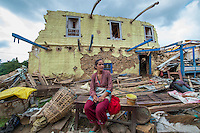 Nepal, Kavre District, Nala, earthquake relief efforts. Visiting destroyed homes on TEWA project supported by Global Fund for Women. Laxmi Dahal (21) and her mother in law, Nirmala, in front of their destroyed home. TEWA is now helping to financially support them.