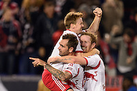 Jonny Steele (22) of the New York Red Bulls celebrates scoring with Dax McCarty (11) and David Carney (8) during the second half against the Chicago Fire. The New York Red Bulls defeated the Chicago Fire 5-2 during a Major League Soccer (MLS) match at Red Bull Arena in Harrison, NJ, on October 27, 2013.