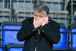 St Johnstone v Celtic.....12.04.11.Peter Lawwell hides his mouth as he talks on the phone.Picture by Graeme Hart..Copyright Perthshire Picture Agency.Tel: 01738 623350  Mobile: 07990 594431