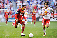 Paulo Araujo Jr. (23) of Real Salt Lake is chased by Mehdi Ballouchy (10) of the New York Red Bulls. The New York Red Bulls and Real Salt Lake played to a 0-0 tie during a Major League Soccer (MLS) match at Red Bull Arena in Harrison, NJ, on October 09, 2010.