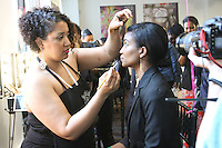 Makeup artist apply makeup onto model during a Ruby Kisses makeup competition, at the Makeup Show NYC, in the Metropolitan Pavilion, May 15 2011.