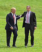 Donald Trump, a candidate for the 2016 Republican nomination for President of the United States, is welcomed by his son, Eric, prior to appearing at the ribbon cutting for the Albemarle Estate at the Trump Winery in Charlottesville, Virginia on Tuesday, July 14, 2015. <br /> Credit: Ron Sachs / CNP<br /> <br /> (RESTRICTION: NO New York or New Jersey Newspapers or newspapers within a 75 mile radius of New York City)