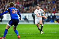 George Ford of England looks to pass the ball. RBS Six Nations match between France and England on March 19, 2016 at the Stade de France in Paris, France. Photo by: Patrick Khachfe / Onside Images