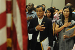 Shengkun Wen becomes United States citizens during a naturalization ceremony in federal court in Oxford, Miss. on Friday, June 29, 2012. Forty seven persons took the oath of citizenship.