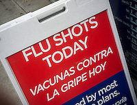A sign in English and Spanish advertises that flu shots are available at a drugstore in New York, seen on Thursday, January 17, 2013.  (© Richard B. Levine)