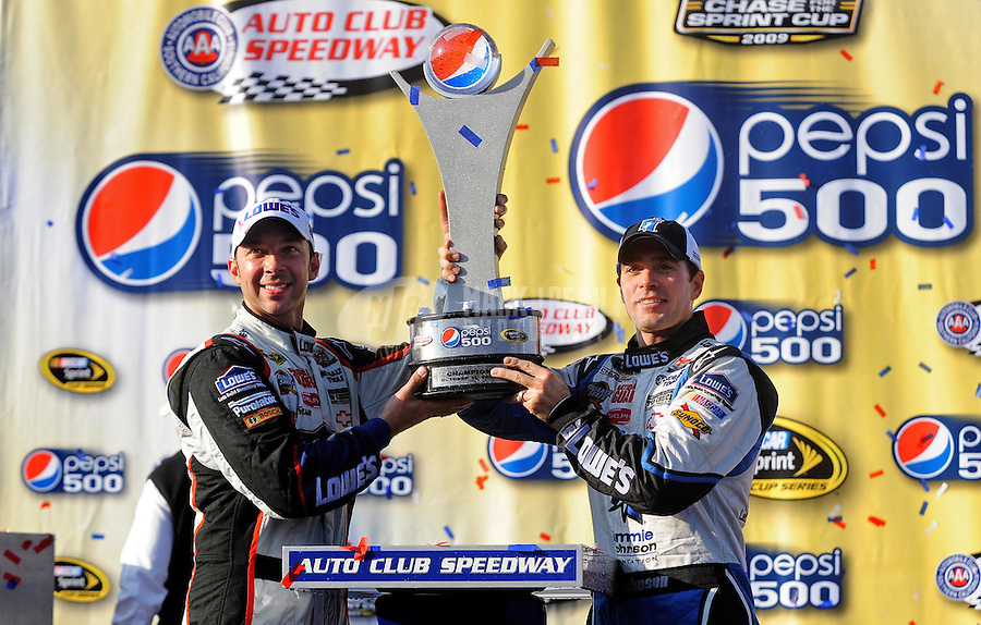 Oct. 11, 2009; Fontana, CA, USA; NASCAR Sprint Cup Series driver Jimmie Johnson celebrates with crew chief Chad Knaus after winning the Pepsi 500 at Auto Club Speedway. Mandatory Credit: Mark J. Rebilas-