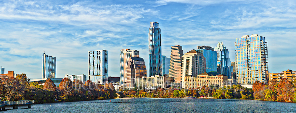 We captured this photo of the Austin skyline along the hike and bike trail from across the lake as the city's high rises buildings crowd along the shore.  Austin is the capital of Texas and we have several universities along with the largest state school the University of Texas and it is also a hub for High Tech companies like IBM, Intel, Dell, AMD, CSC, and many other.  Also Austin has promoted itself as being the Live Music Capital with a good number of musical event going on at any time in this city.  In the  Austin area in the 1970 and 80 the Capital was one of the tallest buildings in the skyline for the city, that is no longer true in the last ten or so year we have a resurgence of building in the downtown area mostly from new high-rise living condos like the Austin 360 and the tallest at 56 stories is Austonian Condos along with several new downtown hotels which have been built recently and a new high rise hotel at  50 stories the Fairmont is coming soon to our skyline which  is constantly evolving.   Even though I miss the old days the skyline for this city is a very impressive site and it has been photography by just about everyone living here I think.  Austin has an impressive skyline from the shore of Ladybird Lake which is goes along the city and from just about anywhere you go on the hike and bike trails you can find a great view of the city.  You can easy see the Austonian which is the tallest at 56 story from just about anywhere and the other high rises like  the Austin 360 and the Frost Bank building as the third tallest in the city along with the new Marriot Hotel as it latest edition to our skyline in this photograph.  We thought the trees along the lake were nice displaying their fall colors which contrast nicely with the blue sky and waters of the town lake, since we usually don't get much fall colors in this area so we like this capture. The city skyline of Austin is constantly changing and shows no sign of slowing down, at least for now.