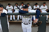 Left fielder Tim Tebow (15) of the Columbia Fireflies in the dugout before his first Class A game against the Augusta GreenJackets on Opening Day, Thursday, April 6, 2017, at Spirit Communications Park in Columbia, South Carolina. (Tom Priddy/Four Seam Images)