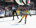 Evelyn Dong (No. 1052) eyes the finish line in downtown Hayward, Wis., as the Bend, NH woman captures the women's title of the 2008 Subaru American Birkebeiner in a time of 2:23:43.4. Shouting encouragement is Andy Weddle (No. 178) of Holly, MI.