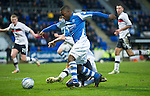 St Johnstone v Dundee.....02.01.13      SPL.Nigel Hasselbaink is tackled by Gary Irvine.Picture by Graeme Hart..Copyright Perthshire Picture Agency.Tel: 01738 623350  Mobile: 07990 594431