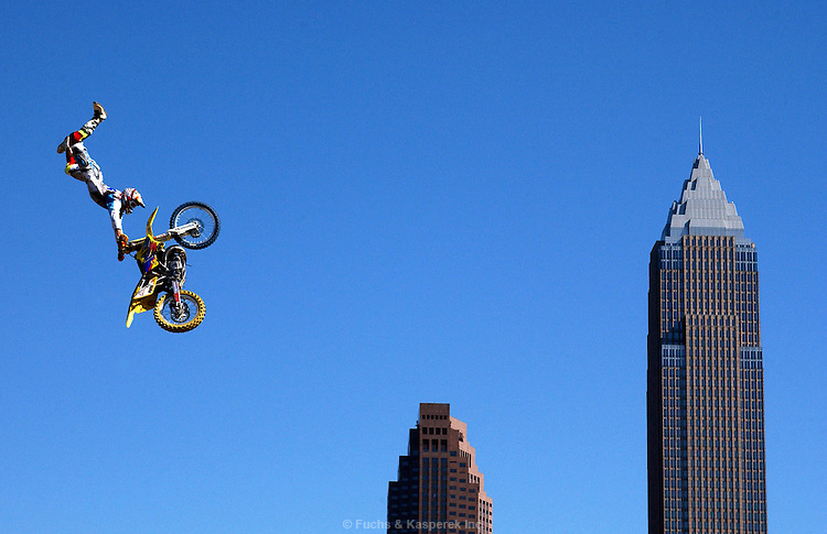 Travis Pastrana of Annapolis, Md. does a backflip during his run in the Freestyle MotoCross competition Saturday afternoon at the Gravity Games in Cleveland, Ohio...Photo by Al Fuchs