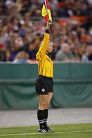 An assistant referee indicates an offside. The women's national team of the United States defeated Canada 6-0 during an international friendly at Robert F. Kennedy Memorial Stadium in Washington, D. C., on May 10, 2008.