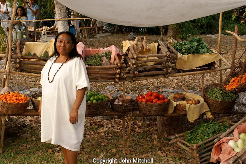 Maya woman selling produce at the recreation of an ancient Mayan market, Sacred Mayan Journey 2011 event, Riviera Maya, Quintana Roo, Mexico
