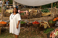 Maya woman selling produce at the recreation of an ancient Mayan market, Sacred Mayan Journey 2011 event, Riviera Maya, Quintana Roo, Mexico