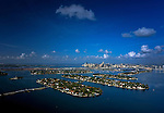 Aerial view of the Venetian Causeway and islands, Biscayne Island, San Marco Island, San Marino Island, Di Lido Island, Rivo Alto Island and Belle Isle with the port of Miami, cruse ships and Downtown Miami in the background.