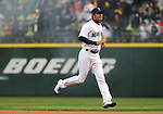 Seattle Mariners' pitcher Iwakuma Hisashi, of Japan, runs towards his teammates after being introduced before their game against the Los Angeles Angels in the  season home opener April 6, 2015 at Safeco Field in Seattle.  The Mariners beat the Angels 4-1.     ©2015. Jim Bryant Photo. ALL RIGHTS RESERVED.