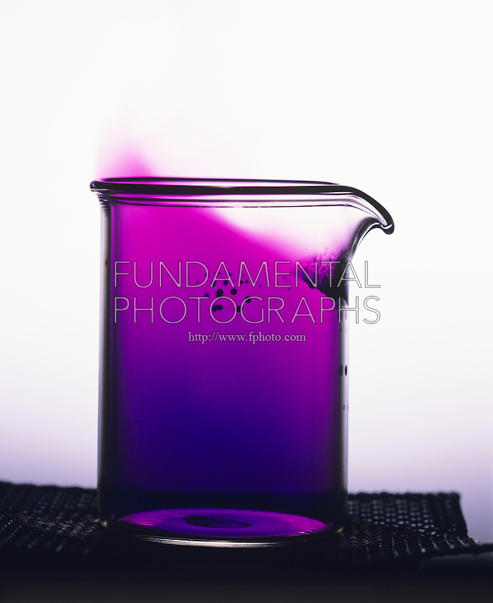IODINE SUBLIMATION SPEEDED BY HEAT<br /> Gaseous Iodine Formed By Heating Iodine Crystals.<br /> Iodine recrystallizes near top of beaker as purple vapor cools.
