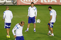 Lionel Messi of Argentina warming up during the training session with Javier Mascherano and Ezequiel Lavezzi