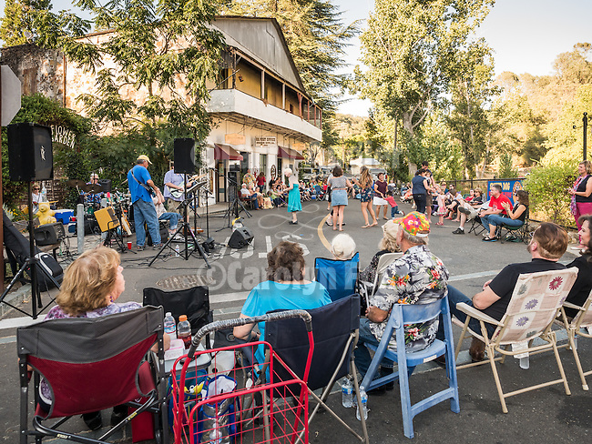 The Spotted Dog Band  performs blues-jazz for the annual Saturday-night Dancin' in the Street on Water Street, Amador City, Calif. during a warm summer evening in August.