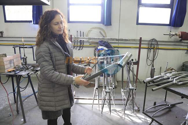 Barbara demonstrates Tommasini's steel mountain bike frame at the Tommasini factory based in Grosseto, Tuscany, Italy 6th March 2017.<br /> Picture: Eoin Clarke | Newsfile<br /> <br /> <br /> All photos usage must carry mandatory copyright credit (&copy; Newsfile | Eoin Clarke)
