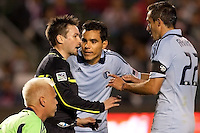 Sporting Kansas City players Omar Bravo (99) and Davy Arnaud (22) have a few words with referee Edvin Jurisevic . Sporting KC defeated CD Chivas USA 3-2 at Home Depot Center stadium in Carson, California on Saturday March 19, 2011...