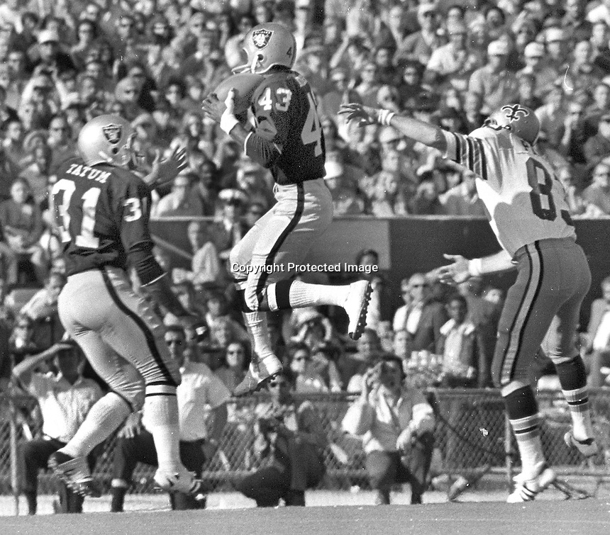 Raiders George Atkinson makes a leaping interception against the New Orleans Saints. (1971 photo/Ron Riesterer)