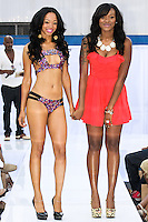 Fashion designer  Tanise Francis walks runway with model at the close of her Fabric Twinz swimsuit runway show, during the JRG Bikini Under The Bridge 2012 fashion show on July 9, 2012.