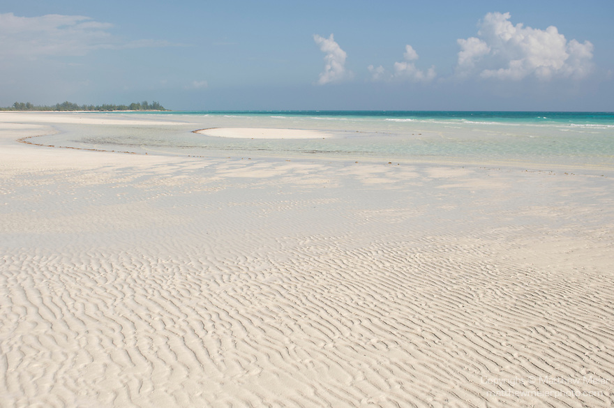 Grand Bahama Island, The Bahamas; the deserted shoreline of Gold Rock Beach, late afternoon at low tide, part of the Lucayan National Park
