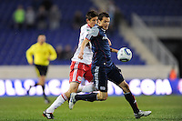 Marko Perovic (29) of the New England Revolution holds off Andrew Boyens (27) of the New York Red Bulls. The New York Red Bulls defeated the New England Revolution 3-0 during a U. S. Open Cup qualifier round match at Red Bull Arena in Harrison, NJ, on May 12, 2010.