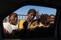 The view from the car window, central Mumbai, faces... beggars on the street, India