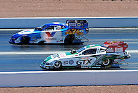 Apr. 5, 2009; Las Vegas, NV, USA: NHRA funny car driver Jack Beckman (left) races Ashley Force during eliminations of the Summitracing.com Nationals at The Strip in Las Vegas. Mandatory Credit: Mark J. Rebilas-
