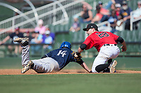 Kannapolis Intimidators first baseman Grant Massey (28) looks to the umpire for a call after applying a tag to Eric Toole (14) of the Asheville Tourists at Kannapolis Intimidators Stadium on May 7, 2017 in Kannapolis, North Carolina.  The Tourists defeated the Intimidators 4-1.  (Brian Westerholt/Four Seam Images)