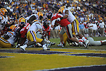 Ole Miss quarterback Bo Wallace (14) scores vs. LSU at Tiger Stadium in Baton Rouge, La. on Saturday, November 17, 2012. LSU won 41-35.....