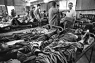 Vietnam. April 1970. Businessman Ross Perot, founder of Electronic Data Systems, Inc., visits the sick bay of a Prisoners of War camp at Phu Quoc Prison in Kien Giang Province, South Vietnam, where 23,000 POW's are held. Perot was appointed by United States Secretary of the Navy John Warner to report on the conditions of Americans in Vietnamese and Laotian POW camps for four years, until the prisoners were released in 1972 at the end of the Vietnam War. Location: Phu Quoc, Kien Giang Province, Vietnam.