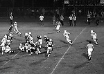 Bethel Park PA:  Offensive play with Mike Stewart 11 is running the option with Chip Huggins 32.  Others in the Photo; Don Troup 51, Clark Miller 30, Tom Skladany 86, Dennis Franks 66, Glenn Eisaman 71.  The offense and defense did not play well in the 12-6 defeat vs Montour. Montour's quarterback, Jim Daniels, killed the Blackhawks.  Jim Daniels was played his college ball at Pitt.  The defensive unit was one of the best in Bethel Park history only allowing a little over 7 points a game.
