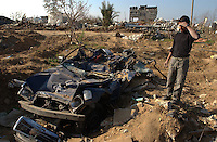 Al Zaytoun, Gaza.  Freih Selmi, 23, stands by his destroyed taxi in the yard of his family house in the town of Al Zaytoun, after the end of the Operation Cast Lead by the Israeli army inside Gaza.   The conflict resulted in between 1,166 and 1,417 Palestinian and 13 Israeli deaths (4 from friendly fire).   (PHOTO: MIGUEL JUAREZ LUGO).
