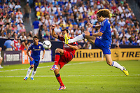 David Luiz (4) of Chelsea FC comes over to take the ball from Nene? (10) of Paris Saint-Germain. Chelsea FC and Paris Saint-Germain played to a 1-1 tie during a 2012 Herbalife World Football Challenge match at Yankee Stadium in New York, NY, on July 22, 2012.